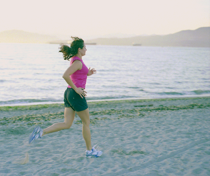 Krista running Kits Beach - taking time off